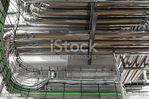 1132919452istockphoto bright wires and chrome pipes. industrial background 1132919469