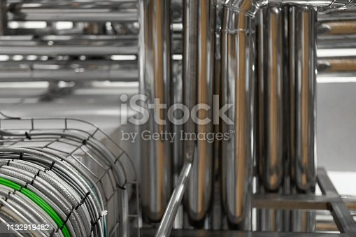 1132919452istockphoto bright wires and chrome pipes. industrial background 1132919482