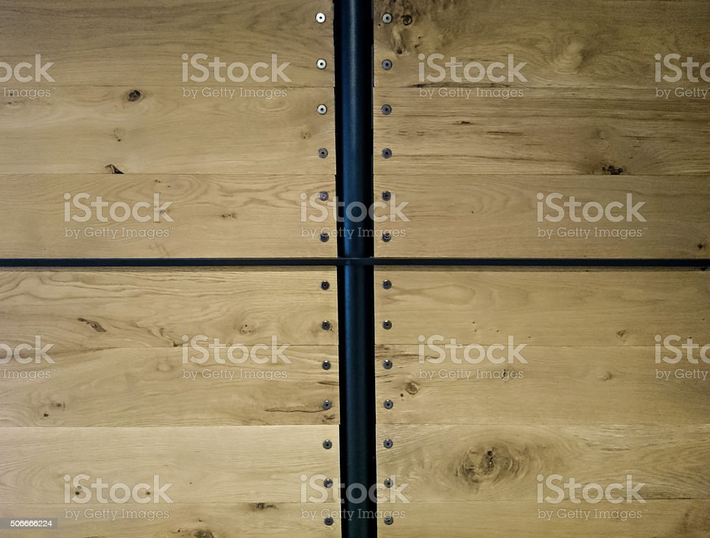 Bright Wooden Wall with Nails and Metal Bar Background stock photo