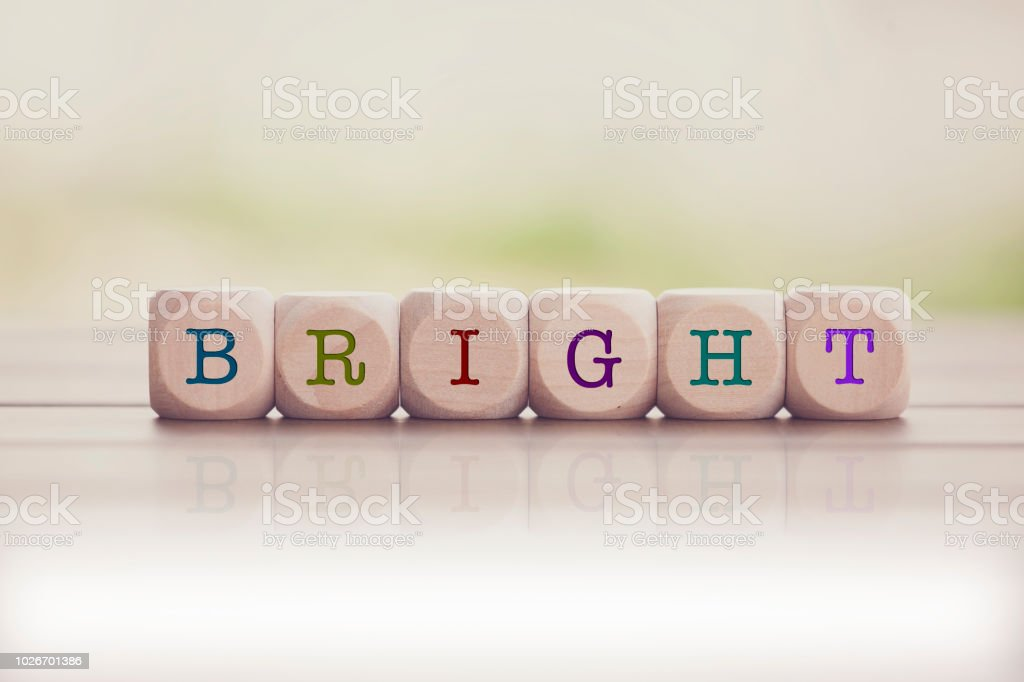Bright Word Written On Cube Wooden Blocks Stock Photo More
