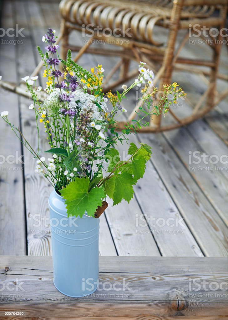 Bright yellow and blue flowers on porch stock photo