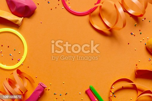 1093222958 istock photo Bright yellow background decorated with festive accessories 1091449370