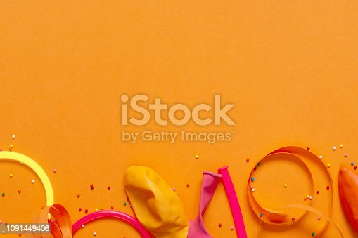 1093222958 istock photo Bright yellow background decorated with festive accessories 1091449406