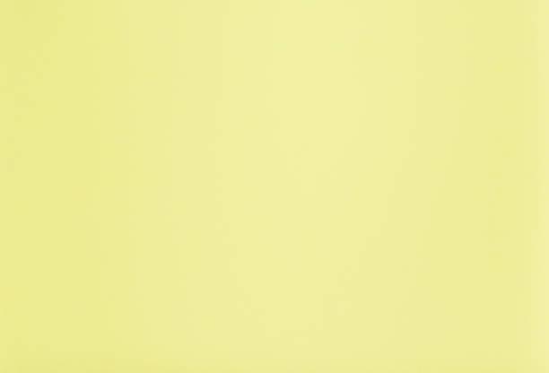 jasnożółte tło - pastelowy kolor zdjęcia i obrazy z banku zdjęć