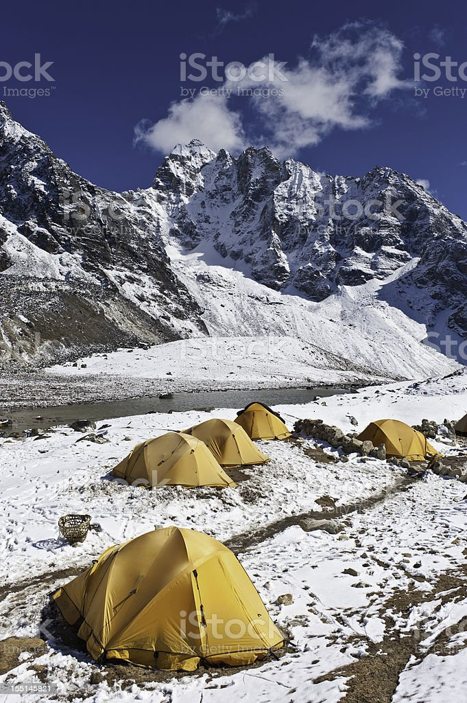 Bright yellow expedition dome tents snow mountain camp Himalayas Nepal royalty-free stock photo