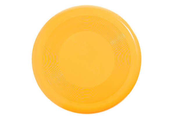 Bright yellow Frisbee on white background An ordinary yellow frisbee, isolated on white. plastic disc stock pictures, royalty-free photos & images