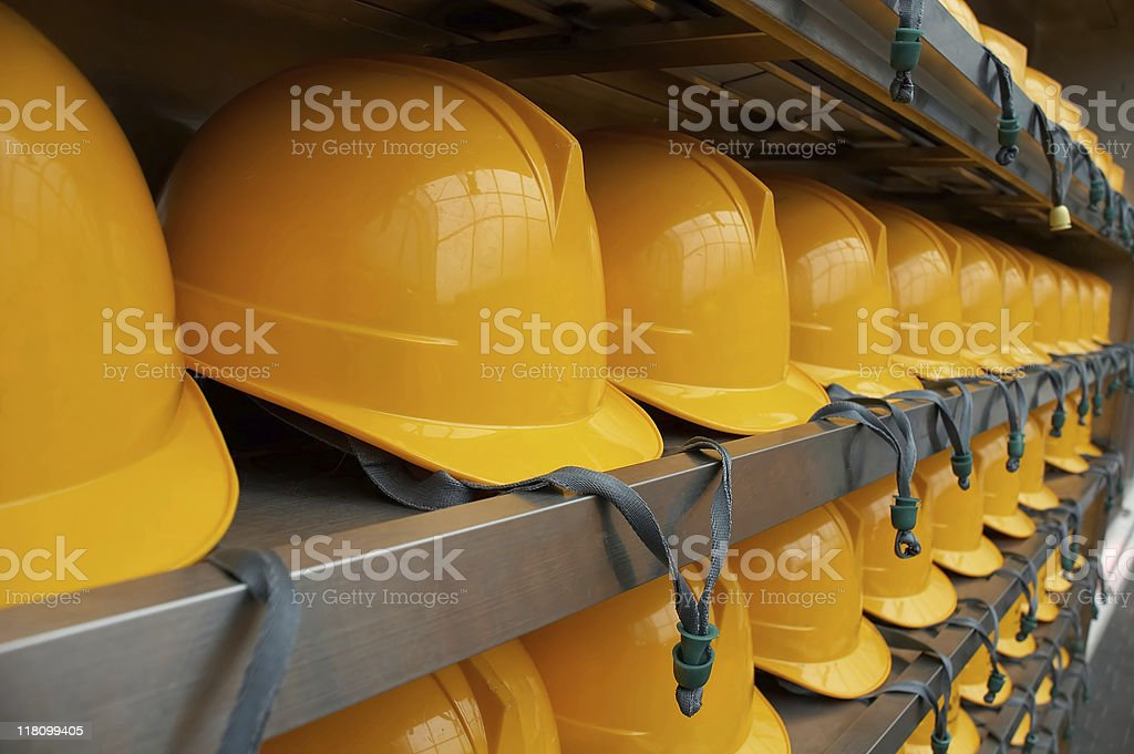 Bright Yellow Hardhats - closeup stock photo