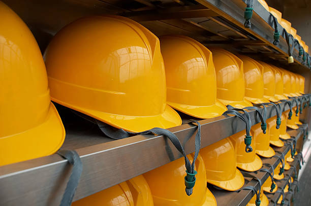 bright yellow hardhats - closeup - arbetssäkerhet bildbanksfoton och bilder