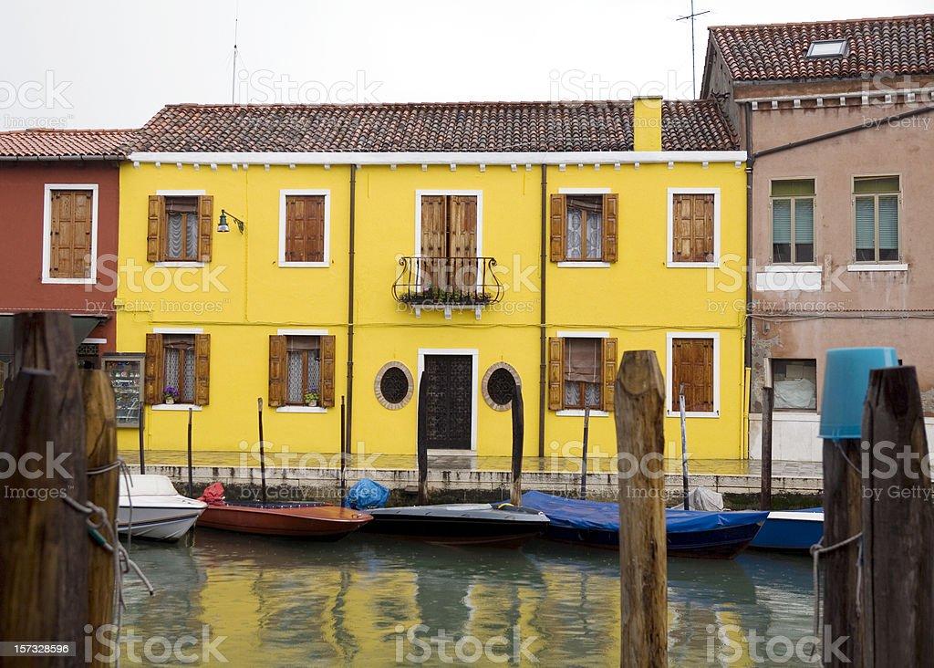 Bright Yellow Home in Murano Venice Italy royalty-free stock photo