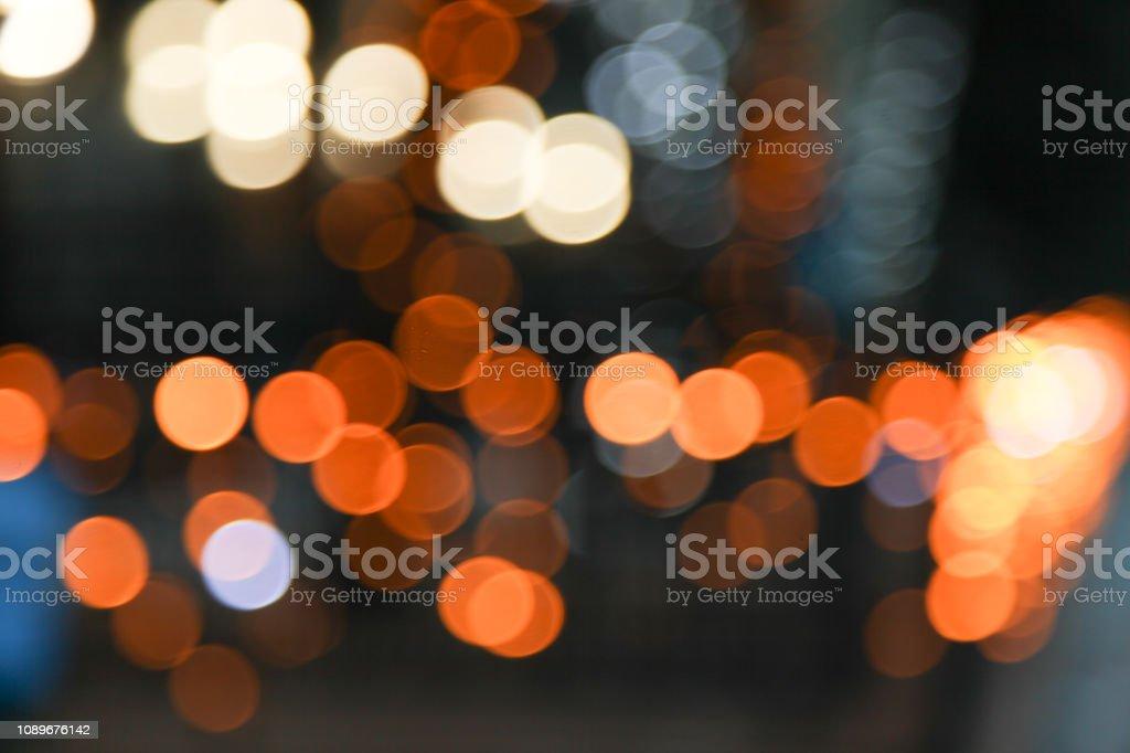 Bright yellow lights in dark, bokeh stock photo
