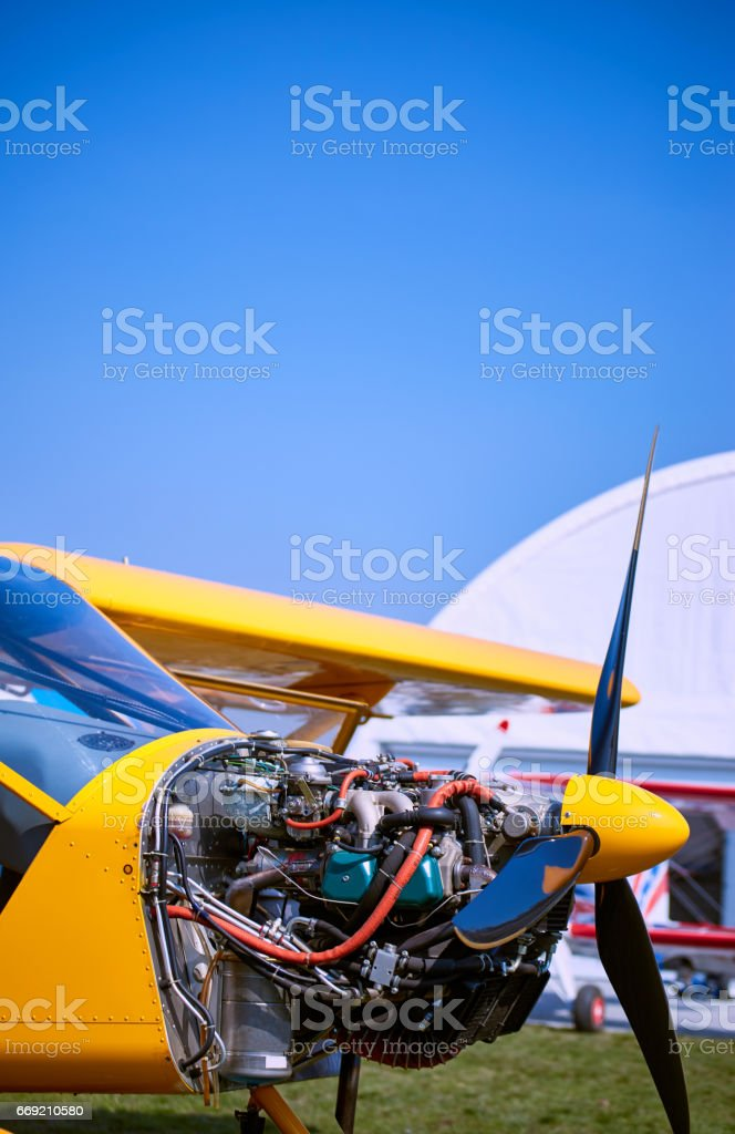 A bright yellow plane on a service on a sunny day. stock photo