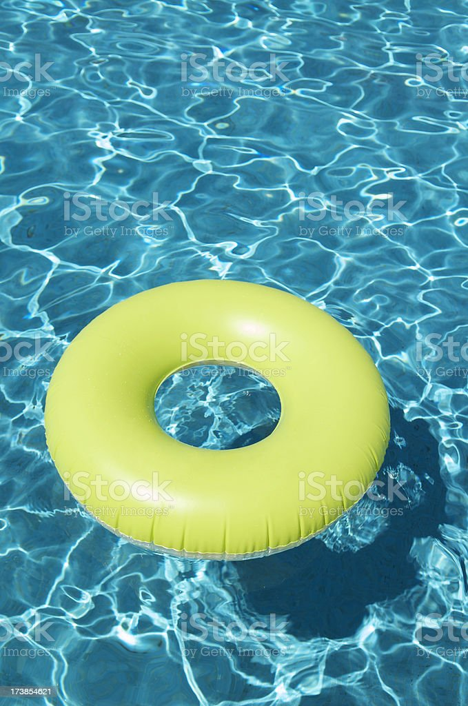 Bright Yellow Pool Ring Floating royalty-free stock photo