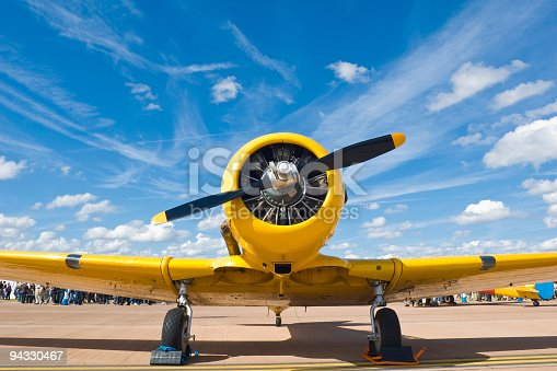 istock Bright yellow propellor aircraft 94330467