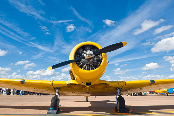 bright yellow propellor aircraft - airshow stock photos and pictures