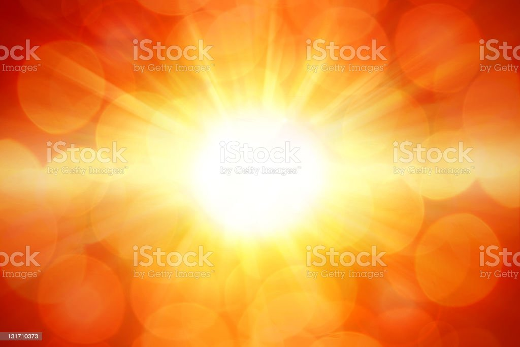 Bright yellow rays of the sun on an orange background  stock photo