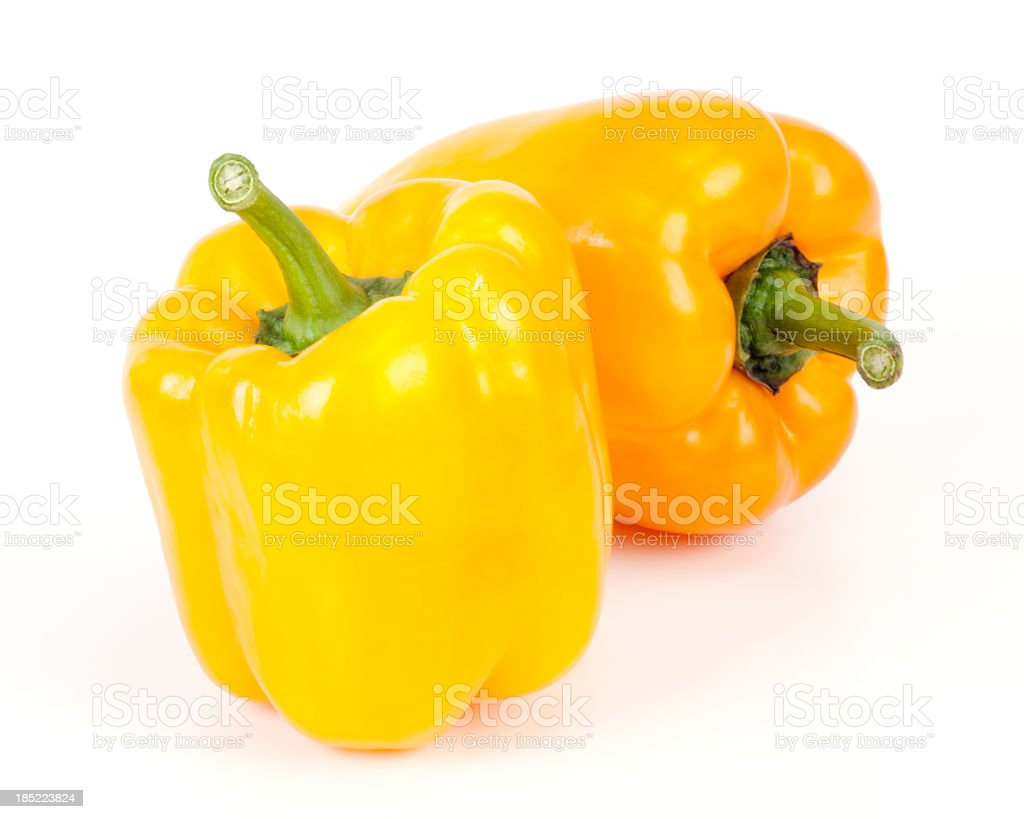 2 bright yellow sweet peppers on white background stock photo