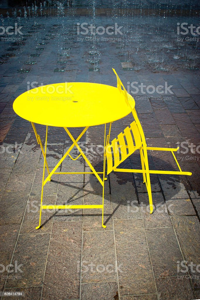 Bright yellow table and chairs stock photo