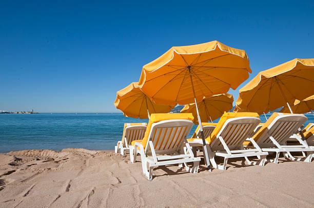 Bright yellow umbrellas on a sand beach