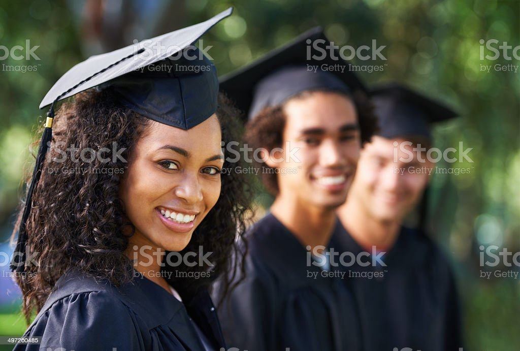 Bright young grads stock photo