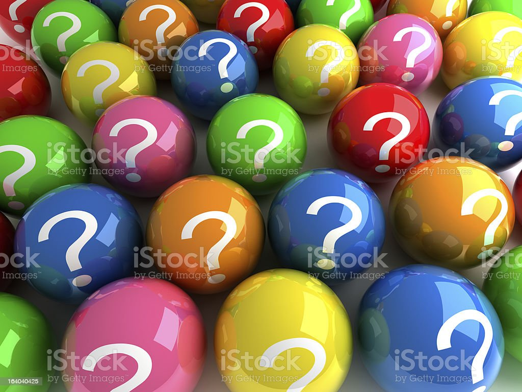 Brightly colored balls with question marks on them royalty-free stock photo