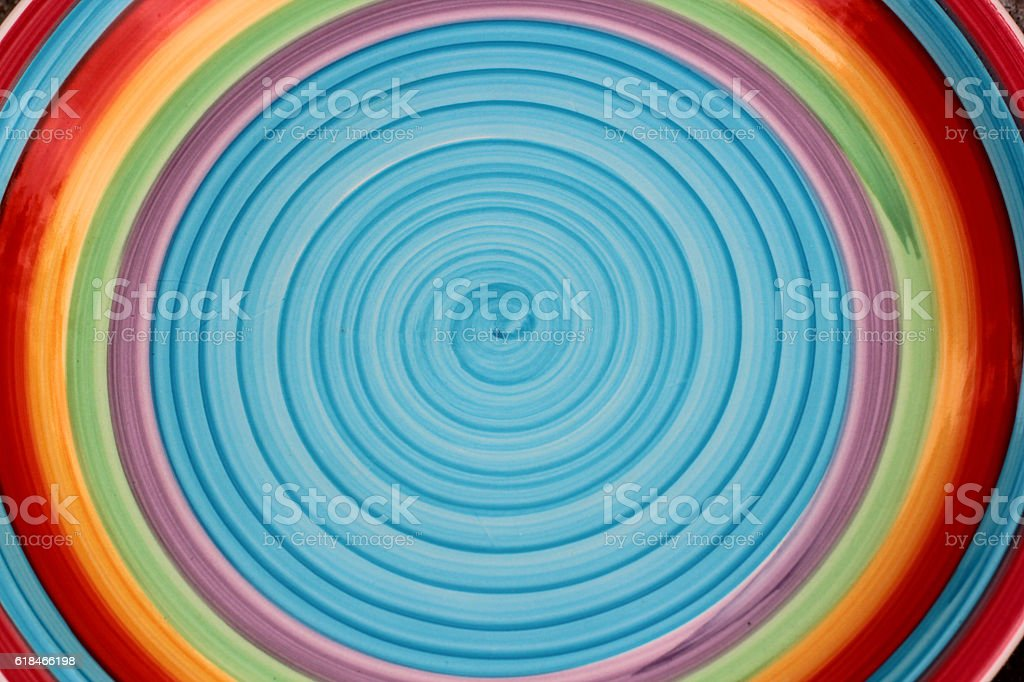 Brightly colored circular background (blue, yellow, red) stock photo