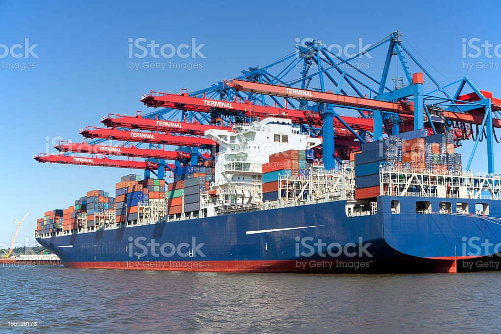 Brightly colored container terminal on waterway royalty-free stock photo