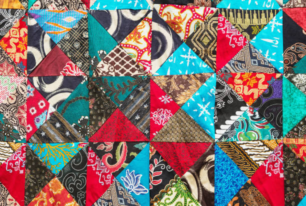 Brightly colored homemade patchwork with abstract patterns stock photo