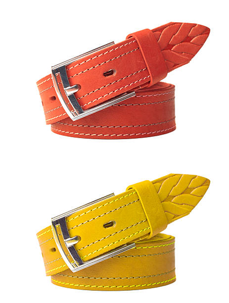 brightly colored leather belts isolated - belt stock photos and pictures