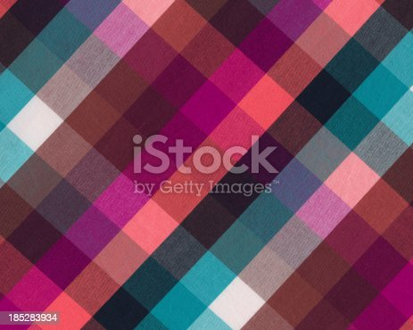 istock brightly colored plaid woven fabric 185283934