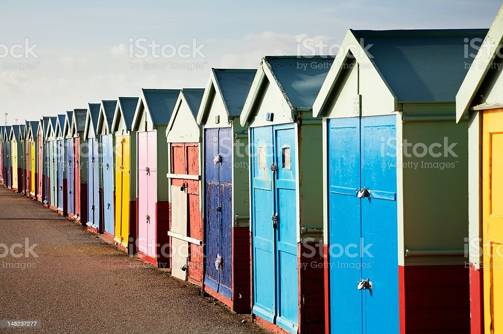 Brightly Colored Wooden Beach Huts stock photo