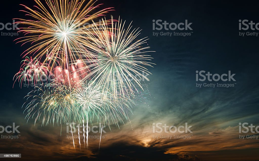Brightly colorful fireworks in the night sky Brightly colorful fireworks and salute of various colors in the night sky 2015 Stock Photo