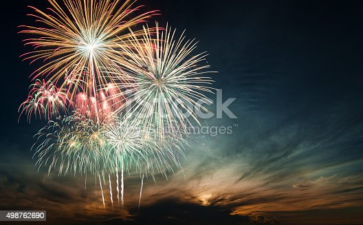 istock Brightly colorful fireworks in the night sky 498762690