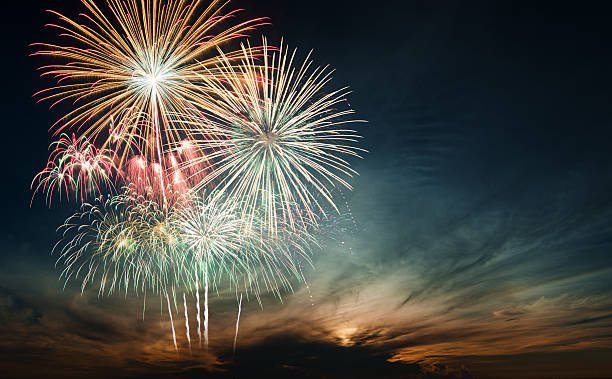 brightly colorful fireworks in the night sky - fireworks stock pictures, royalty-free photos & images