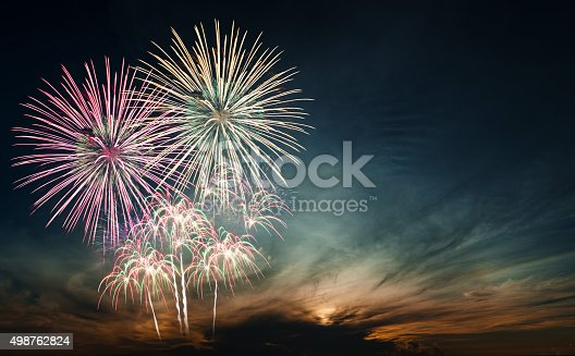 istock Brightly colorful fireworks in the night sky 498762824
