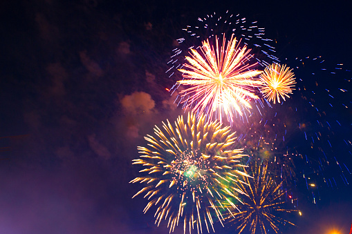 istock Brightly colorful fireworks in the night sky 959353004