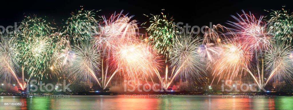 Brightly Colorful Fireworks isolated black background. New Year celebration fireworks. stock photo