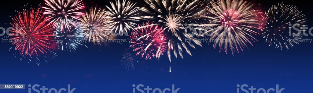 Brightly Colorful Fireworks on twilight background - party celebration concept stock photo