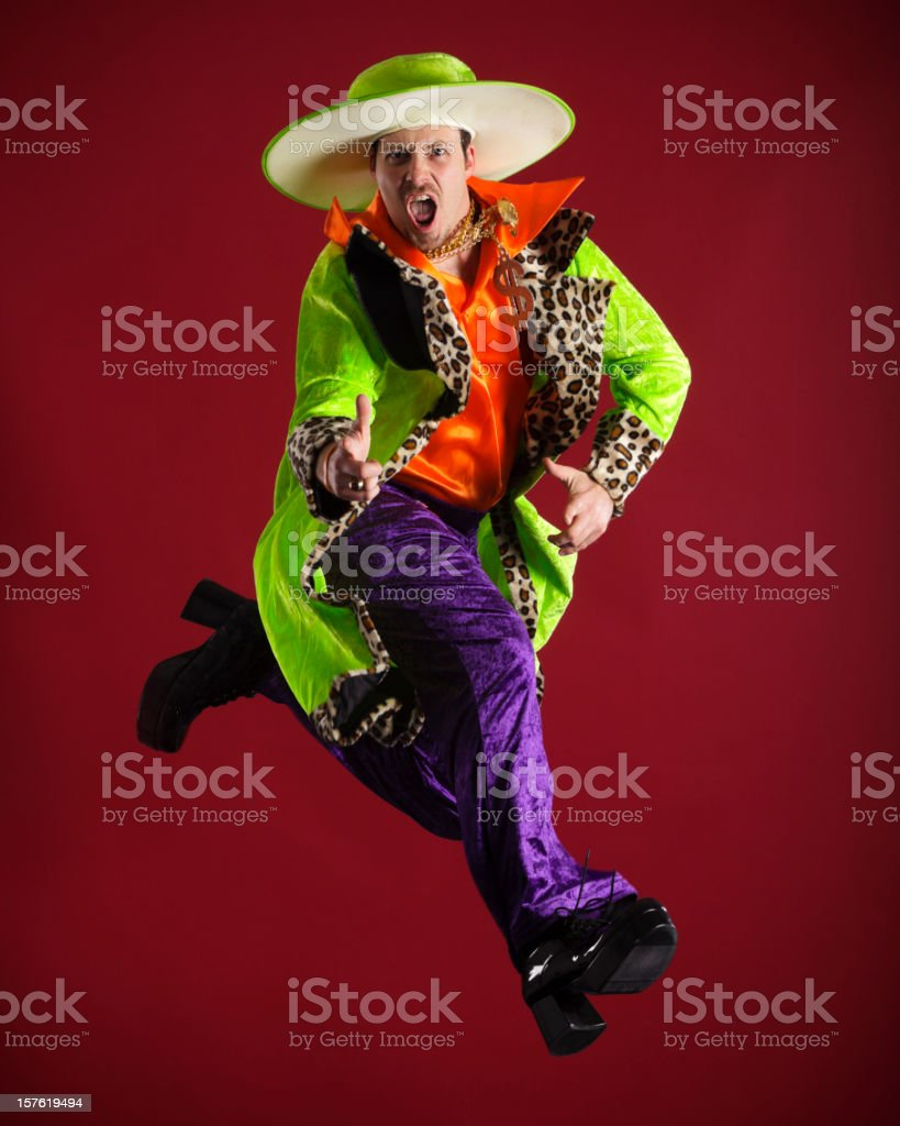 Brightly Dressed Man in Mid-Air royalty-free stock photo