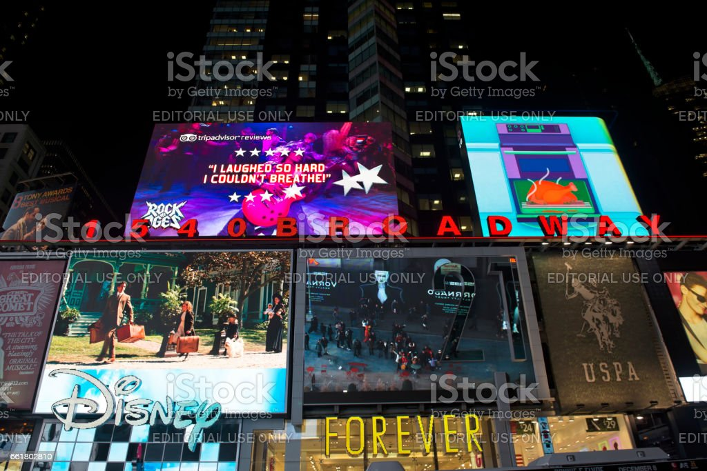 Times Square and the Broadway theatre district during night is one of...