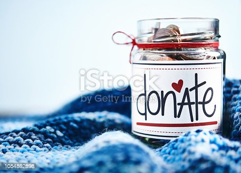 Donation money jar filled with coins