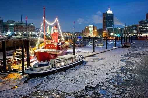 Brightly lit Hamburg harbor at night