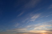 Brightly lit in sunset  blue sky in white cirrus clouds