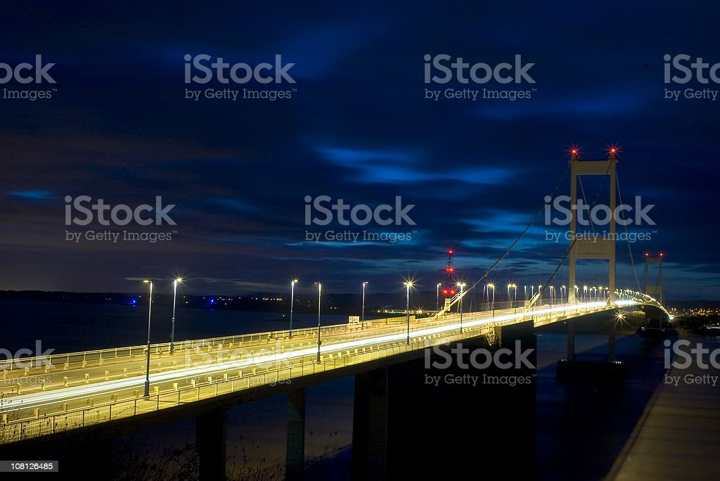 Brightly Lit Suspension Bridge at Night royalty-free stock photo
