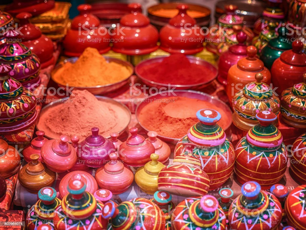 Brightly painted jars used to hold kumkura or kumkum powder used in Hindu celebrations and worship, for sale at Varanasi market, India stock photo