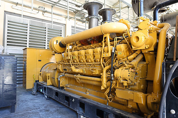 Brightly painted yellow diesel generator stock photo