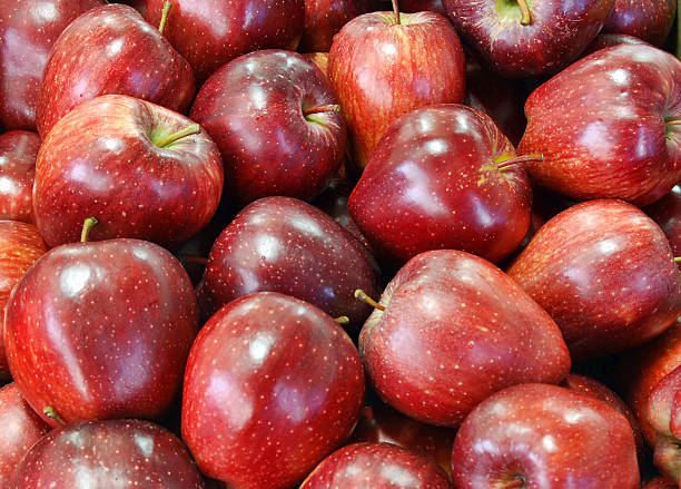 Brightly red apples texture Fresh and brightly red apples group from harvesting red delicious apple stock pictures, royalty-free photos & images