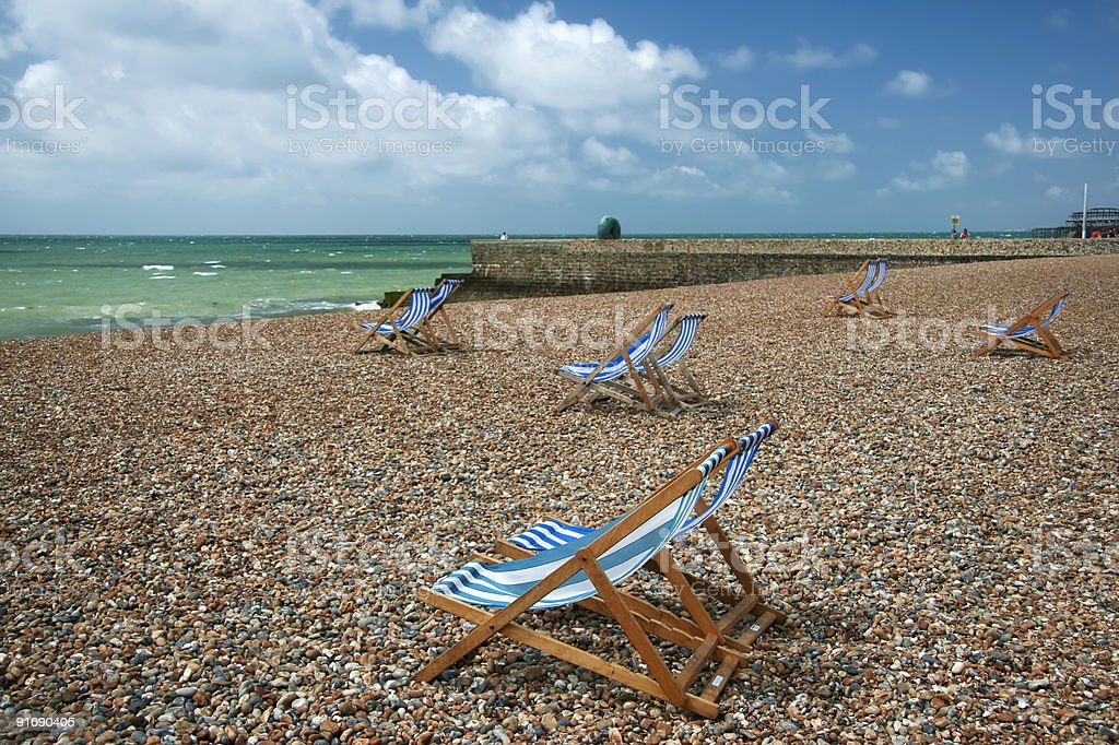 brighton beach deck chairs west sussex uk stock photo