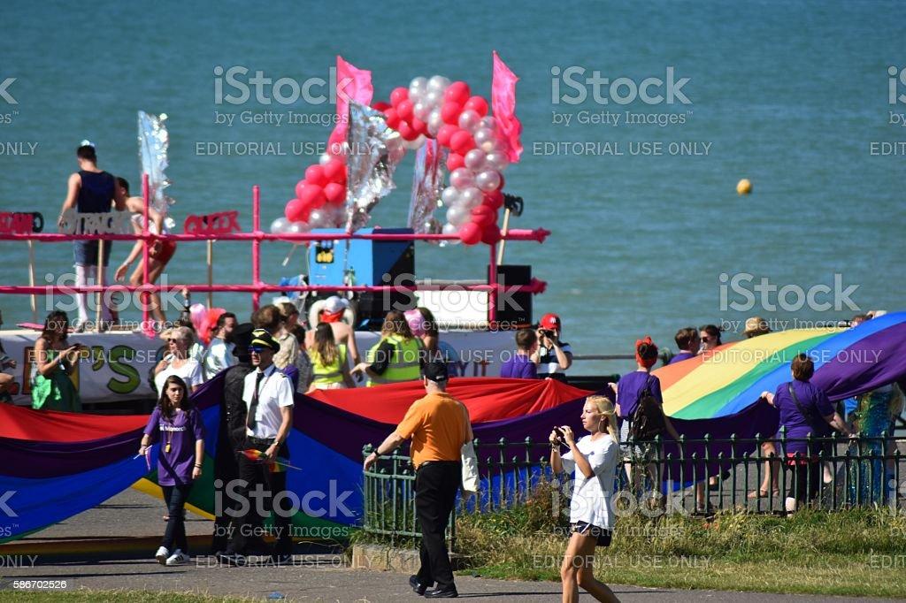 Brighton Gay Pride 2016 Giant Rainbow flag on promenade stock photo