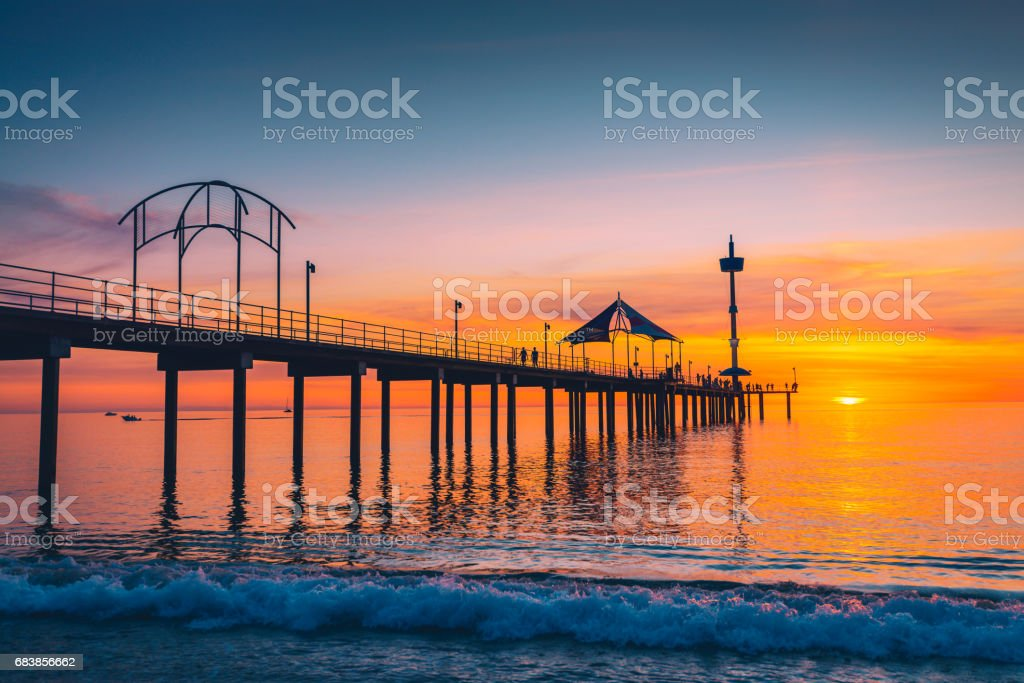 Brighton Jetty with people at sunset stock photo