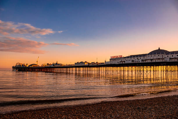 Brighton Pier Sunset Brighton Pier at sunset. southeast england stock pictures, royalty-free photos & images